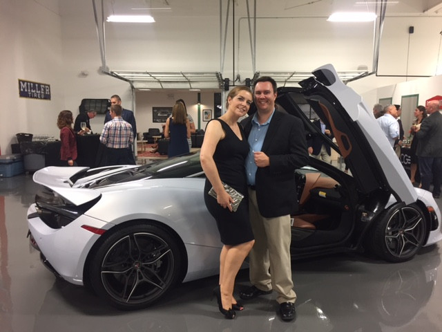 Jennifer and her husband pictured with the new McLaren 720S