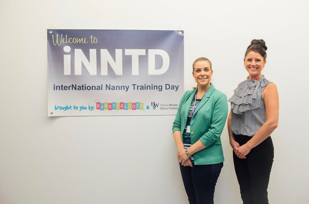 Jennifer Laurence and event organizer Cate Matijevich pictured with event sign
