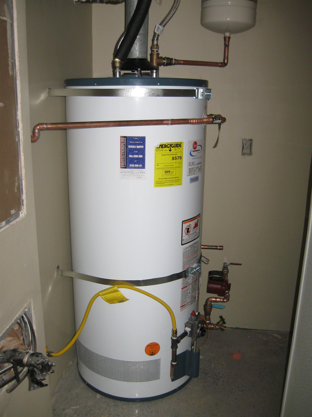Standard Tank Water Heater in basement of house