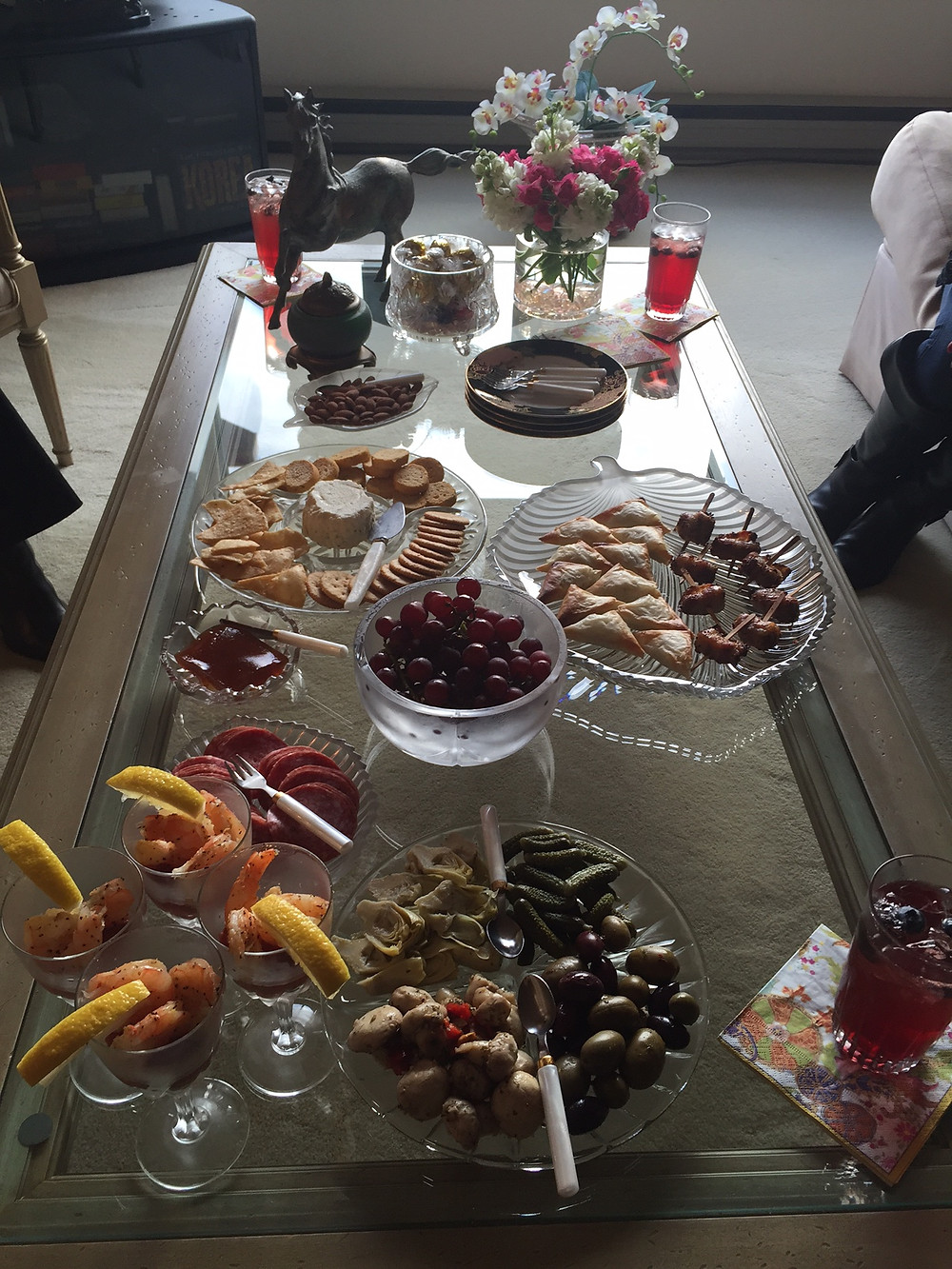 A glass coffee table with appetizers