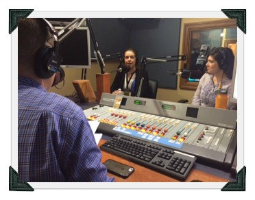 Ms. Jennifer Laurence pictured in the radio studio with host and cohost of show