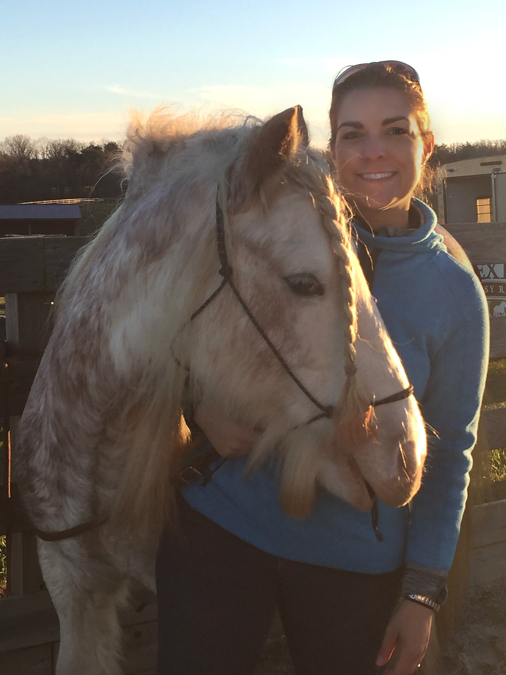 Jennifer with Willy the White Horse outside on the ranch