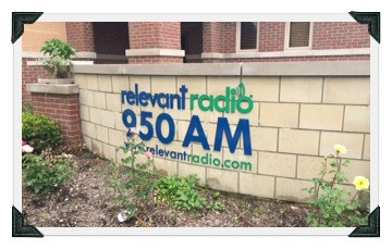 Relevant Radio 950 AM station sign outside building
