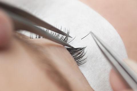 Traditional eyelash extensions. Selectiv