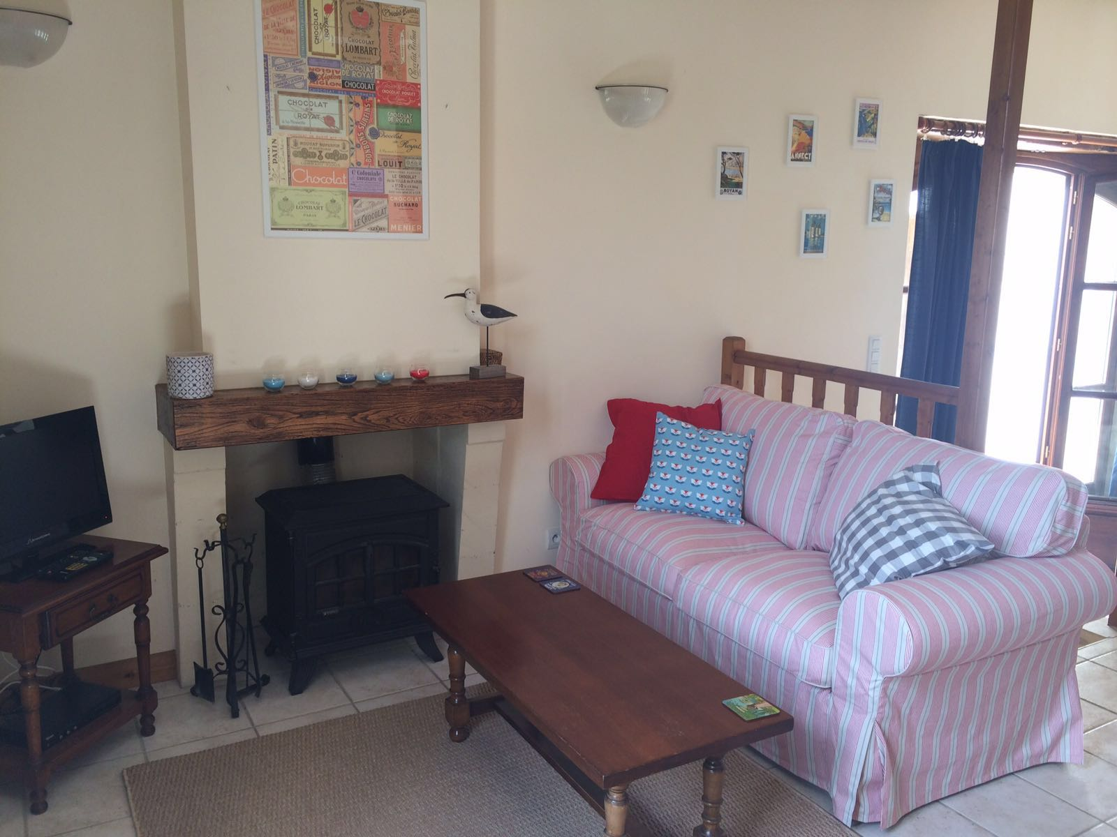 Cosy sitting room with log burner