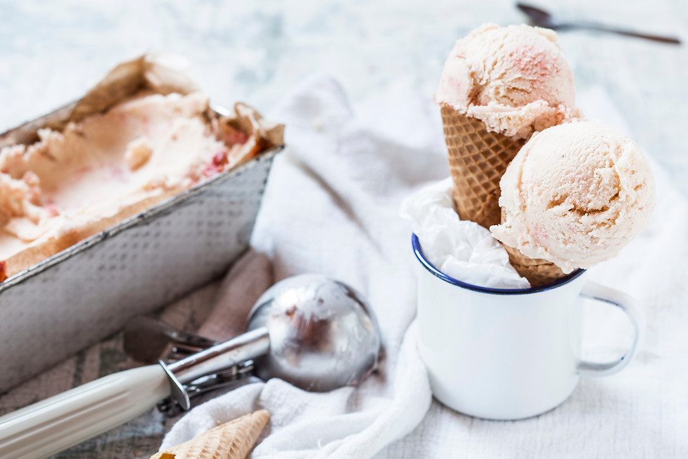 Homemade ice cream, ice cream scoop & two cones
