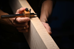 Marking the thickness before sawing the cello ribs