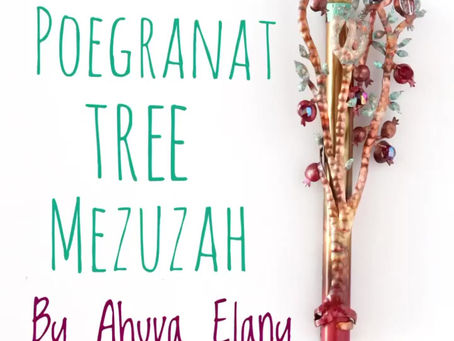My new Mezuzah with two Love Birds sitting on a pomegranate tree.