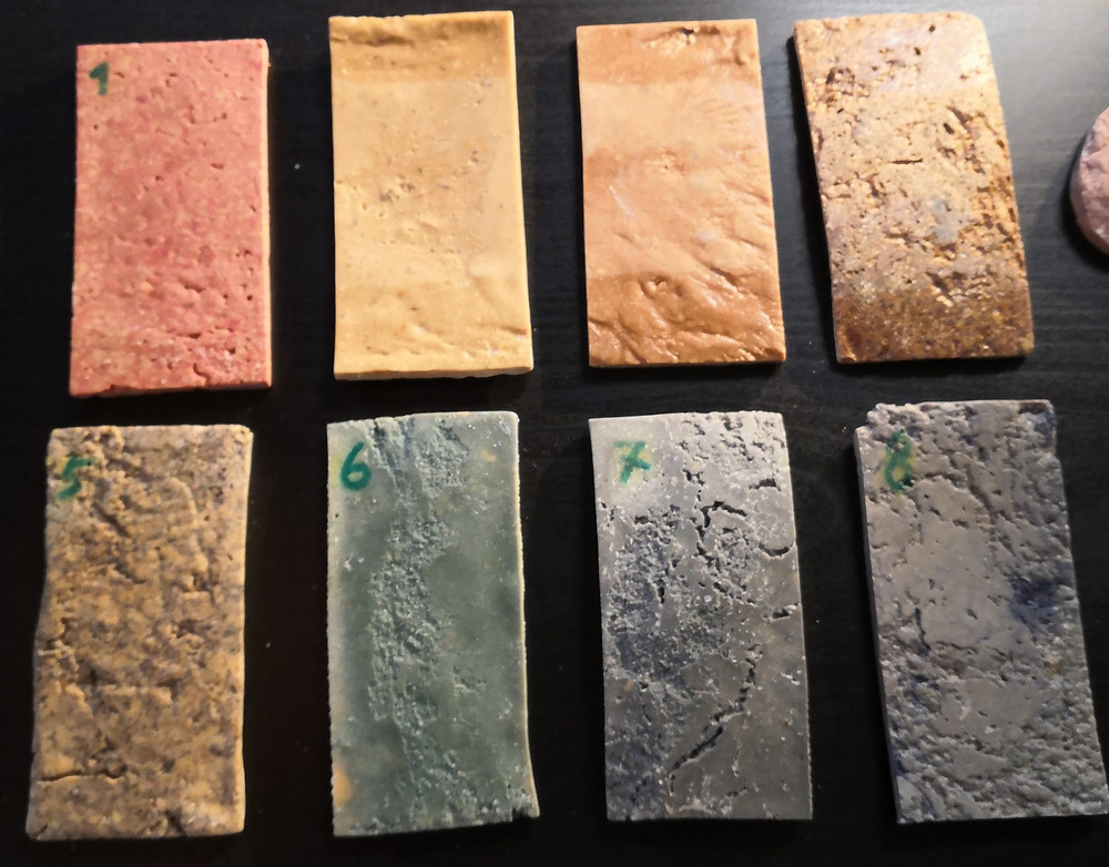 Several small slabs in different colours of a material made out of casein.