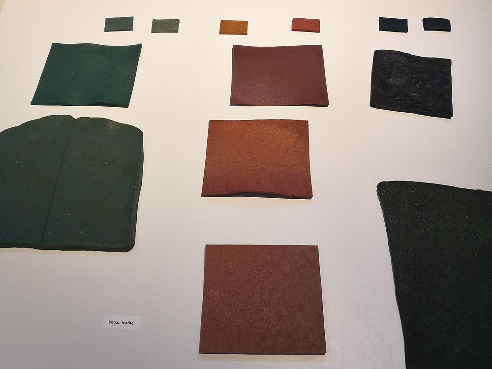 Different coloured squares cut out of a leather substitute material.