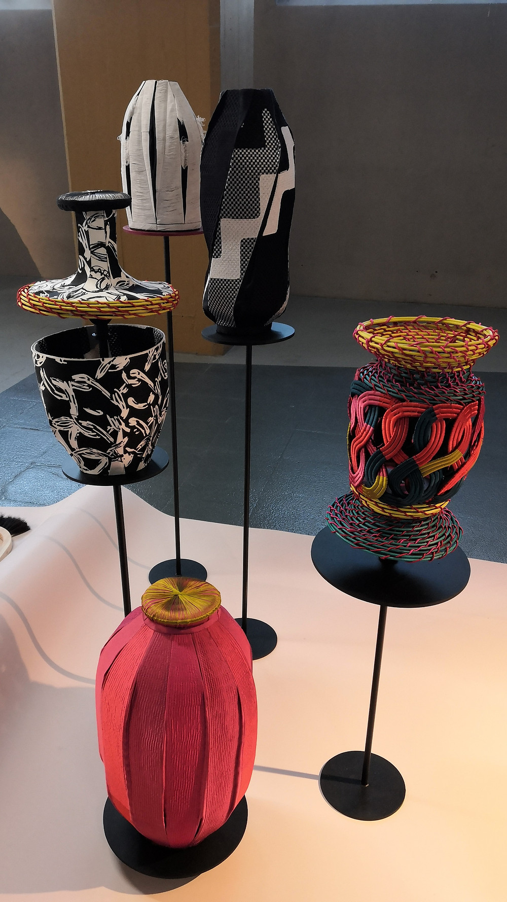 Black, white and red baskets with woven, embroidered and printed patterns