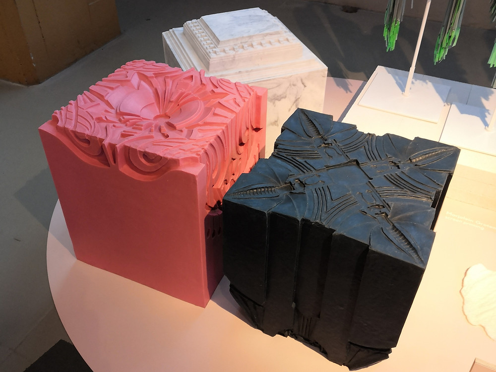 Large, decorative cubes cast in plastic. Pink, white and black.