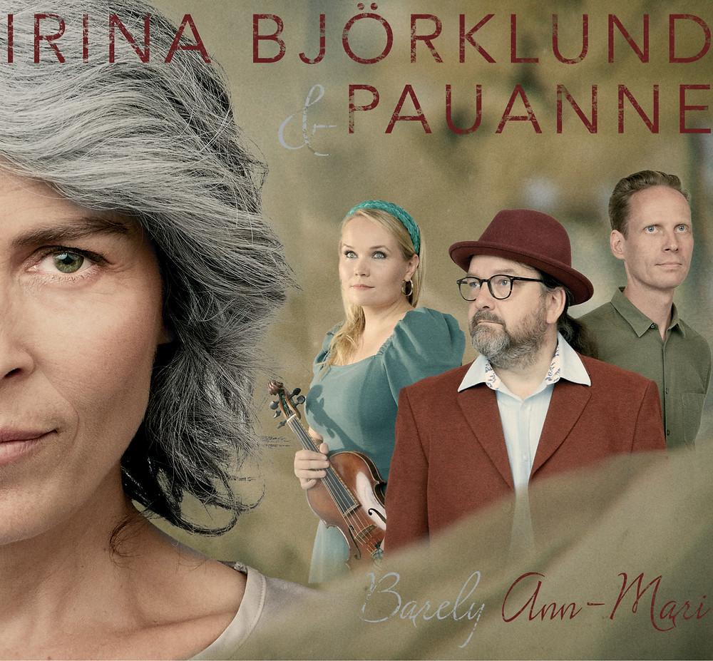 """Irina Björklund ja Pauanne -yhtye levynsä kansikuvassa, kuvassa tekstit """"Irina Björklund & Pauanne"""" ja """"Barely Ann-Mari"""""""