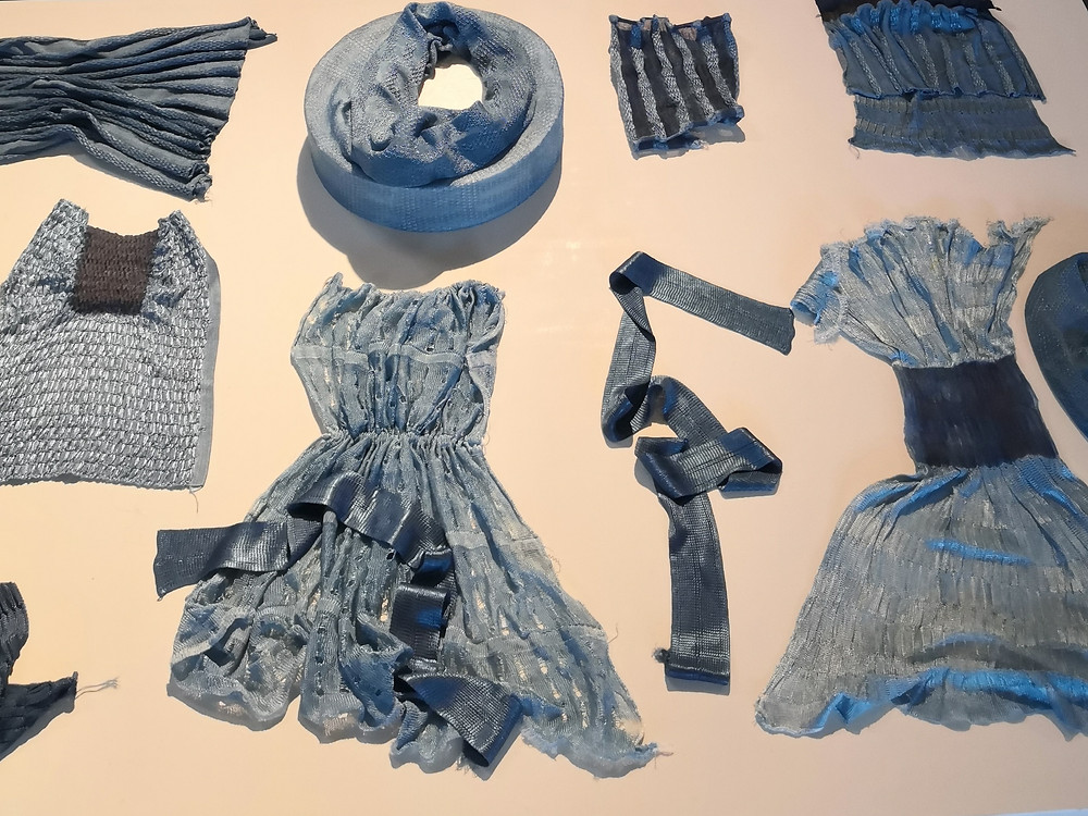 Swaths of different materials dyed blue.