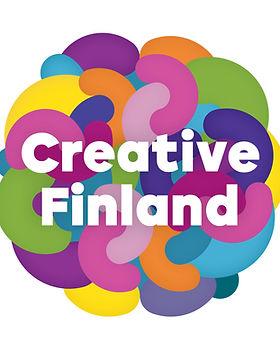 """Erivärisistä muodoista koostuvalla, pyöreähköllä pohjalla valkoinen teksti """"Creative Finland""""."""