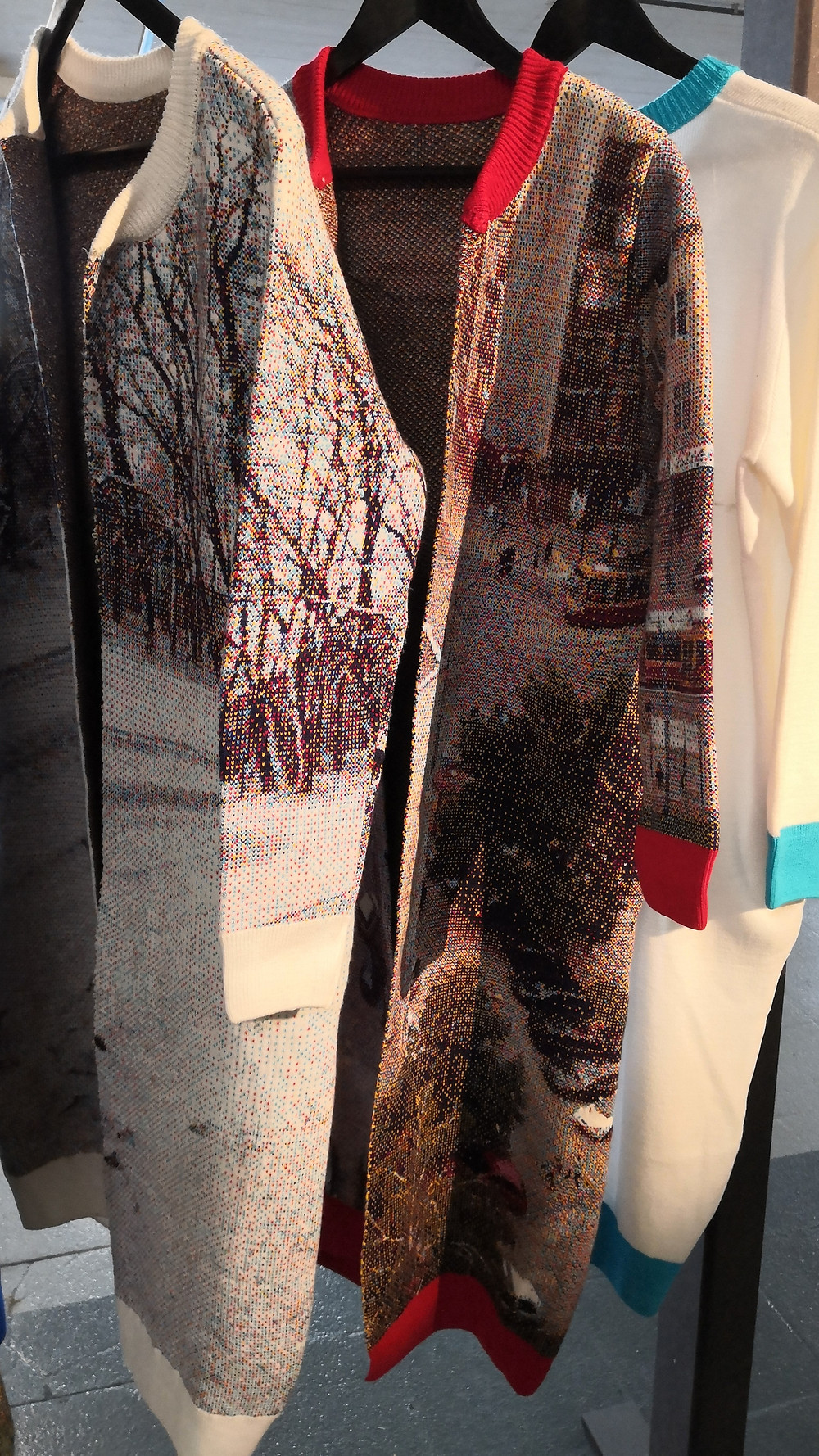 Two long cardigans with photographic images woven onto them.