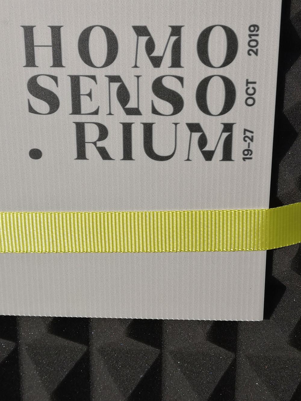"""A plaque that reads """"Homo Sensorium"""""""