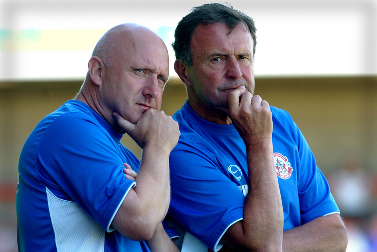 Crawley managers Alan Lewer and John Hollins ponder their next move