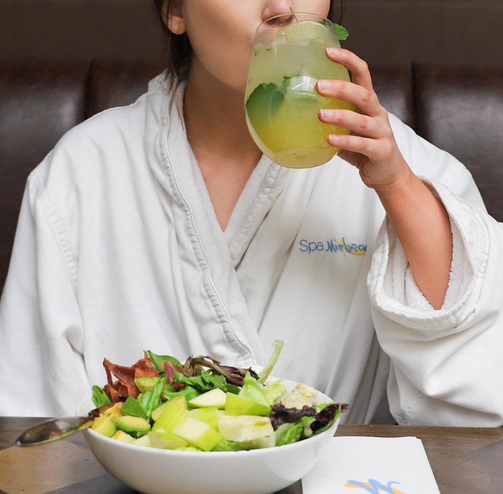 female in robe enjoying lunch