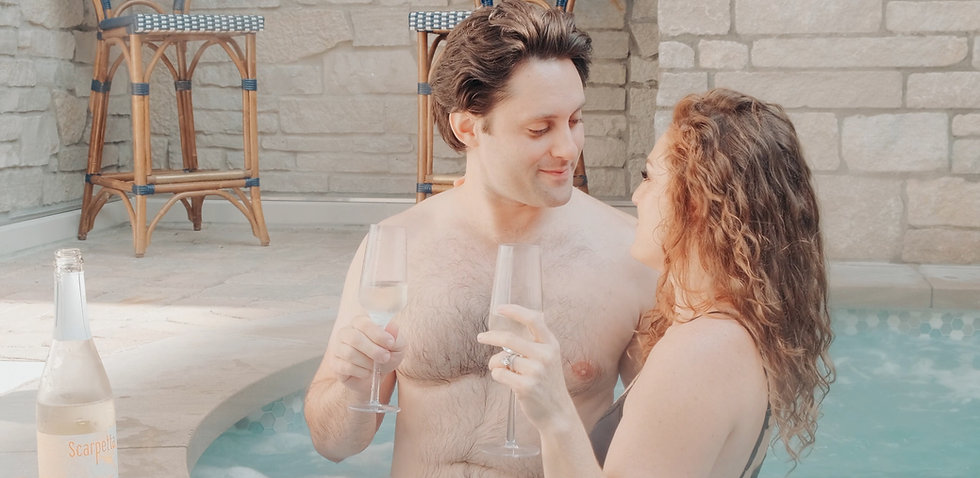 couple sharing a drink in the hot tub