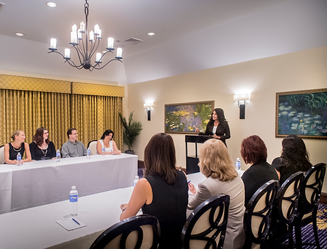 Guests enjoying a presentation in one of our banquet halls.