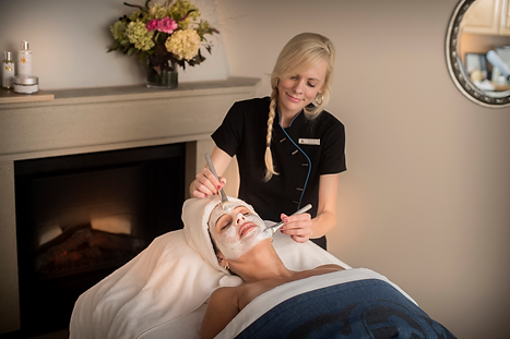 A female receiving a facial treatment from one of our spa employees.