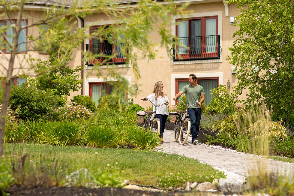 couple with bikes in garden