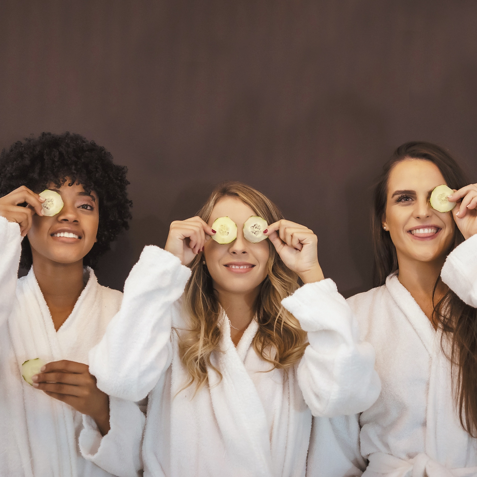 a group of ladies with cucumber on their eyes