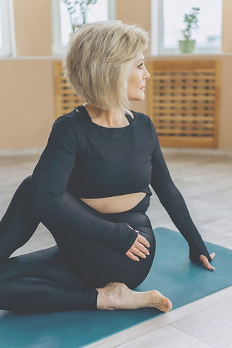 Female preforming yoga stretches
