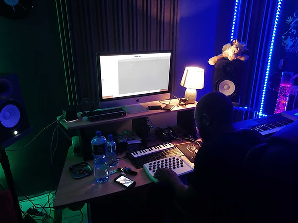 MixedbySimba using the first Joyst prototype in a studio