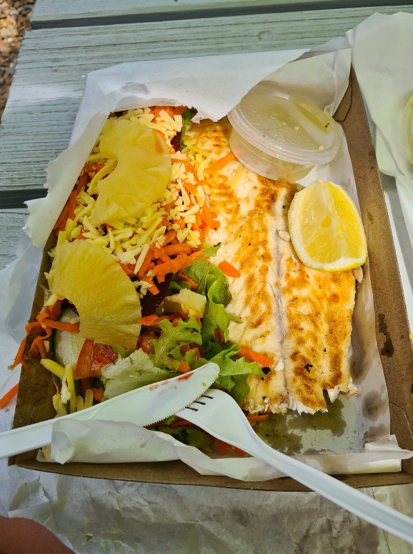 A delicious grilled fish takeaway at Coral Sea seafood