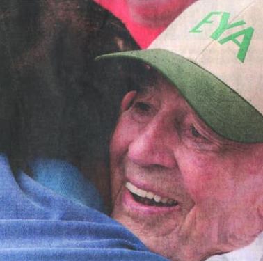 Jack Eckerd hugging a camper