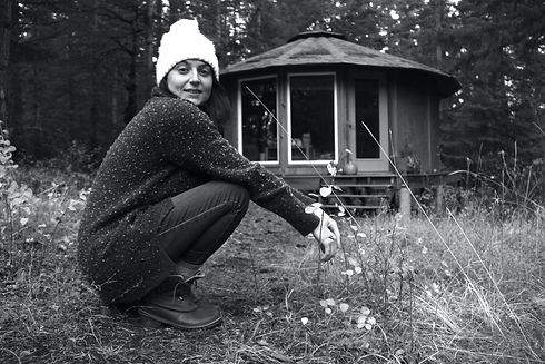 a woman connecting to nature living in a yurt