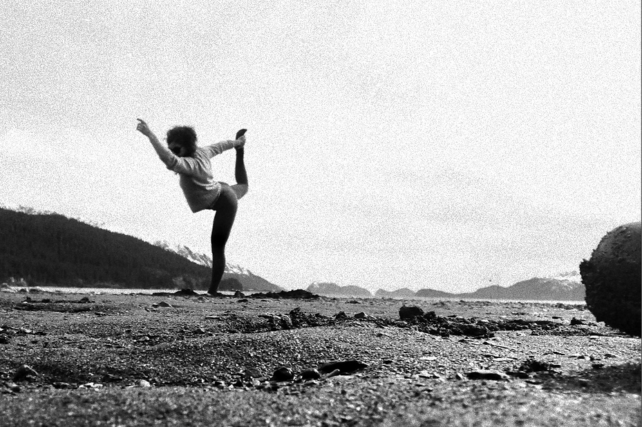 a woman practicing yoga in nature in alaska