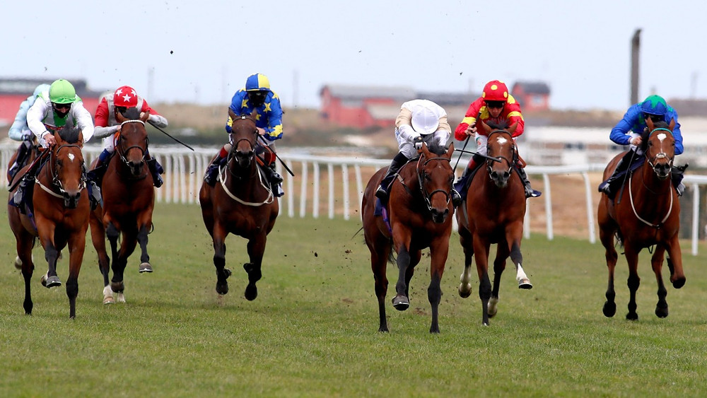 The Lir Jet (centre,) makes a winning debut for trainer Michael Bell at Yarmouth (Pool)
