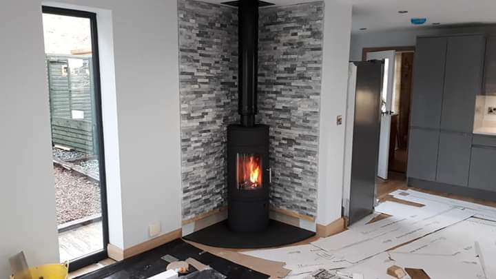 Split face wall tile & slate hearth