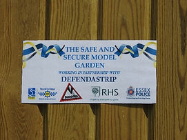 Sign close up on fence at RHS Hyde Hall.