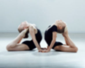 two little gymnast girls in black suit i