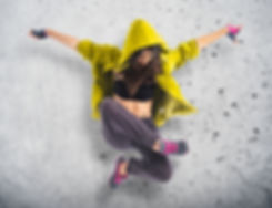 Teenager girl dancing hip hop over textu