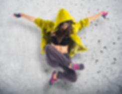 Teenager girl dancing hip hop over textu