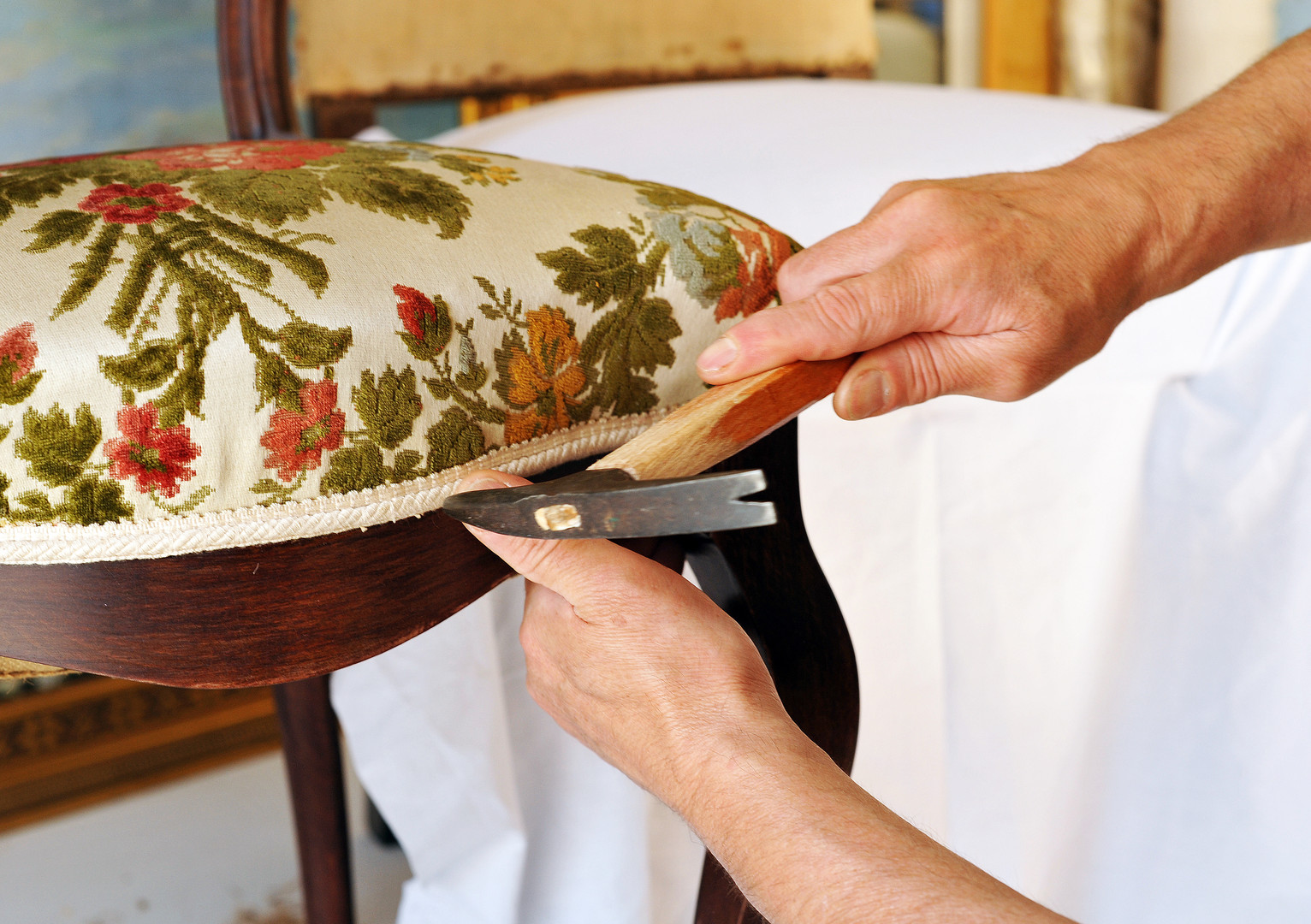 Upholsterer repairs an antique chair