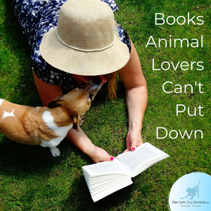 "Woman reads a book while dog licks her face with title ""Books Animal Lovers Can't Put Down"""