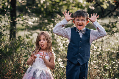 brother and sister kids making silly faces family photo session dressed up monticello mn