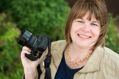 Karen Leuch photographer st cloud mn holding camera