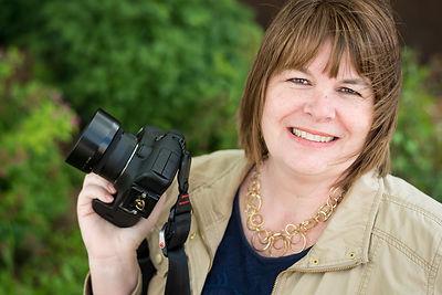 Karen Leuch photographer st cloud mn holding camera