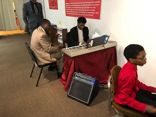 Brother teaching music.jpg