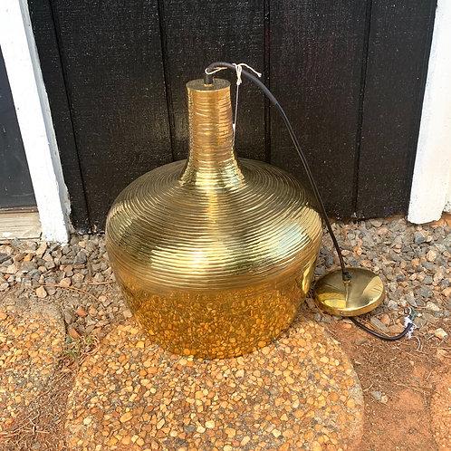 Round brass pendant