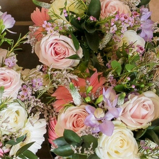 Hand tied bouquets pink and cream roses