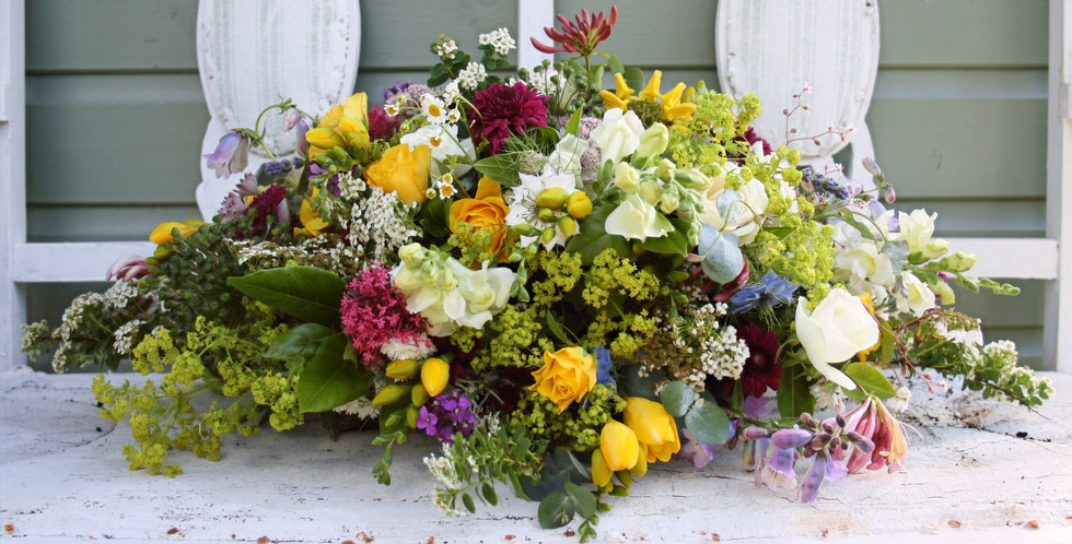 Country flowers tribute arrangement