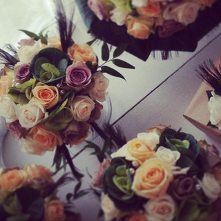 Rose and peacock feather bouquets